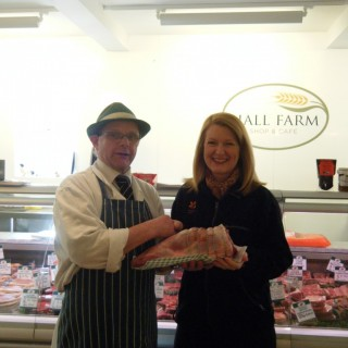 Sharon King collecting her free leg of lamb from Rob.